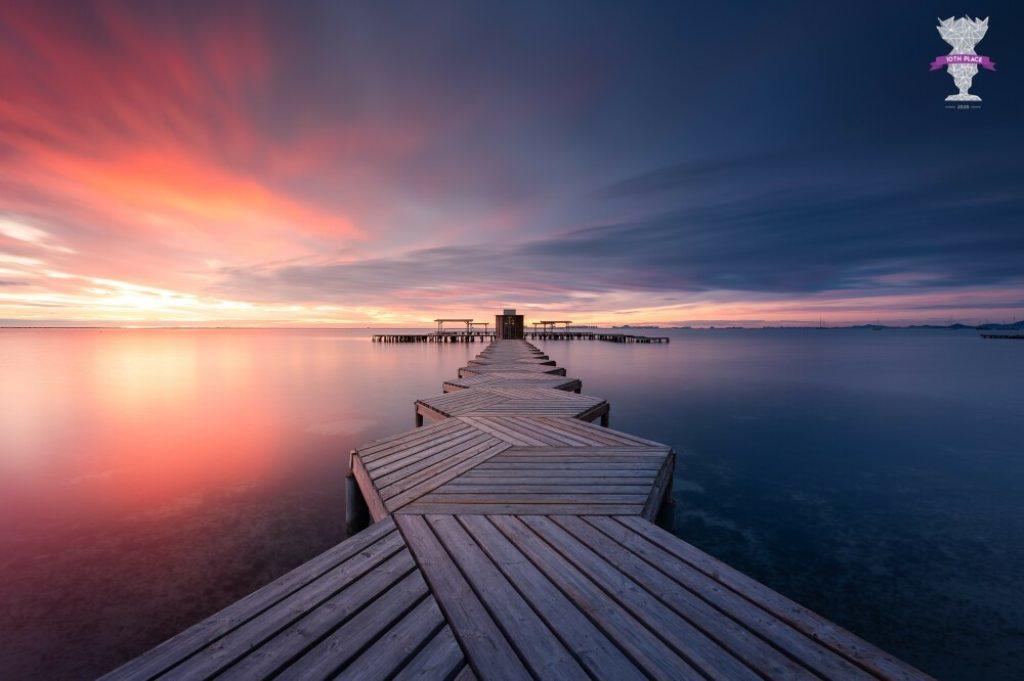 Photo arrivée 10eme à un concours international : ponton en espagne au lever de soleil