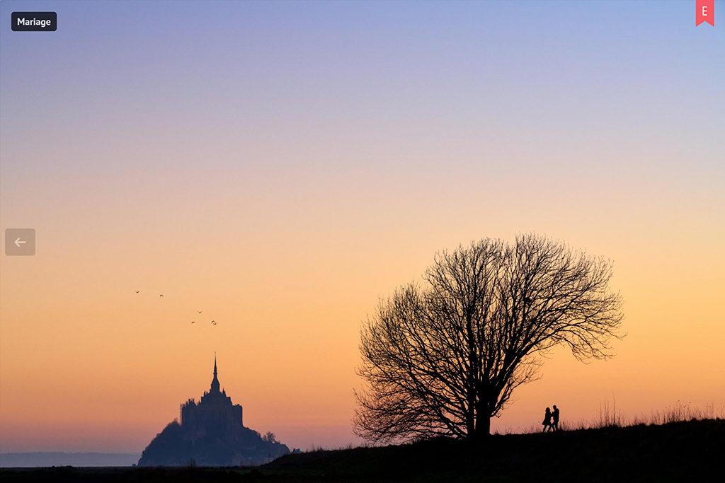 Photo du mont saint michel avec un couple dansant sous un arbre en silhouette, récompensée par un choix éditeur sur mywed